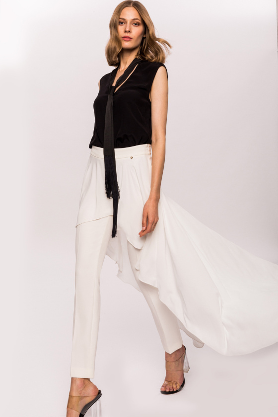 Trousers with asymmetric skirt layer
