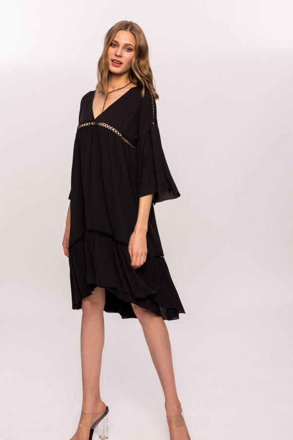 Dress with holes and V neckline