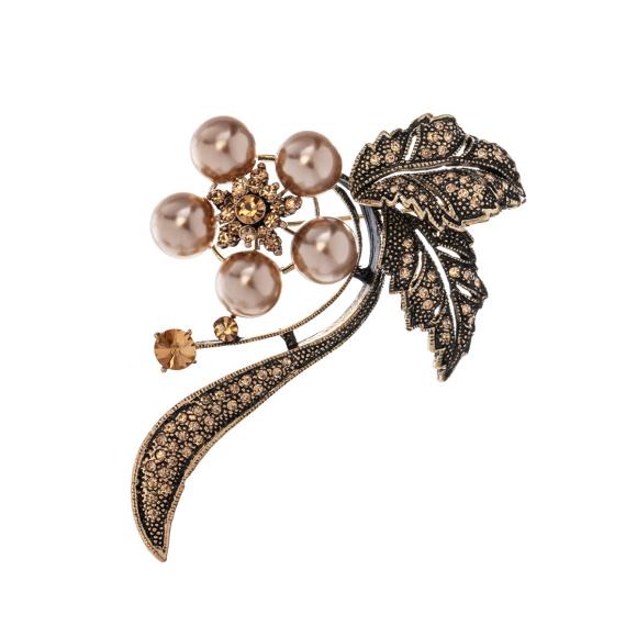 Brosa stralucitoare cu detalii tip perle