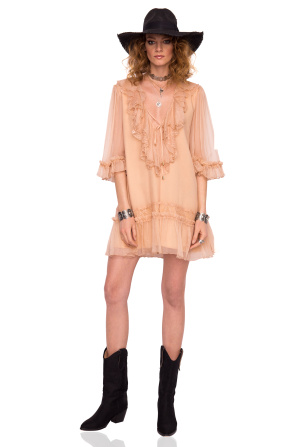Loose silk dress with ruffles and lace details