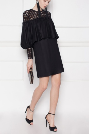 Ruffled black dress with lace inserts